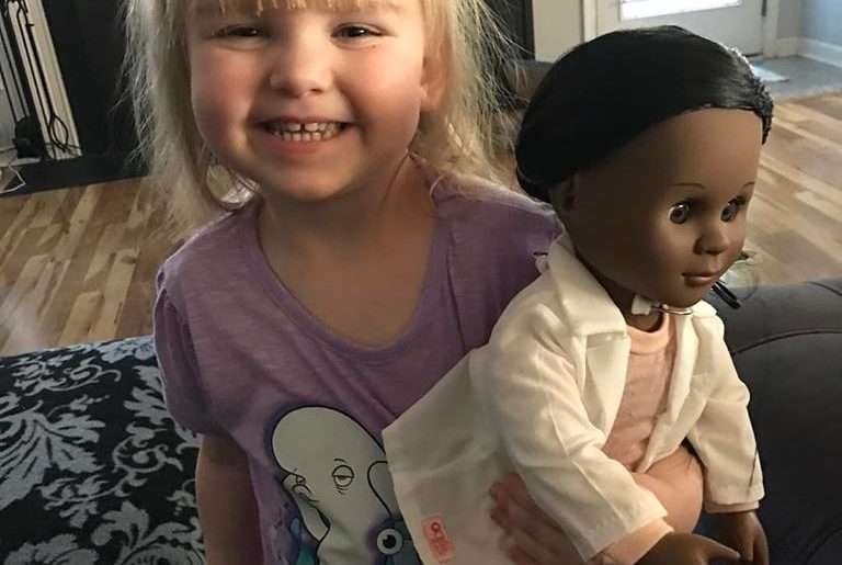 Girl defends her choice of doll to cashier