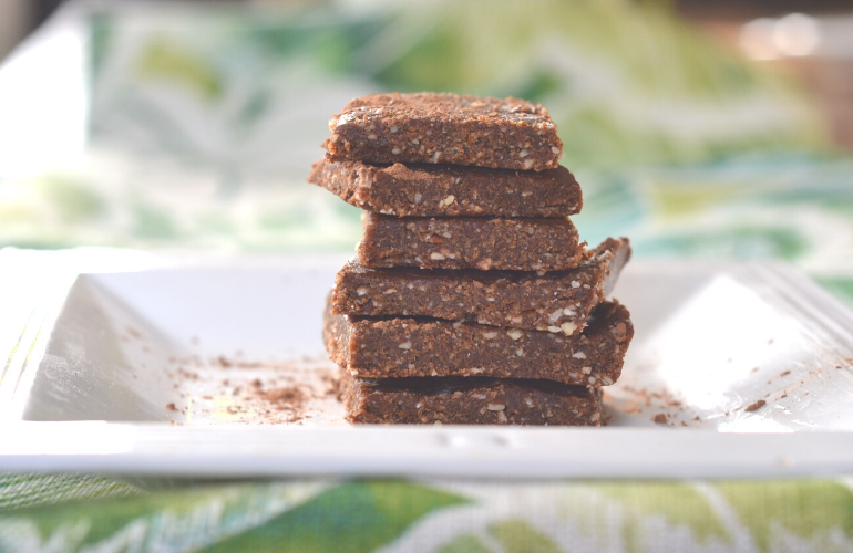 Almond date energy bars on a plate